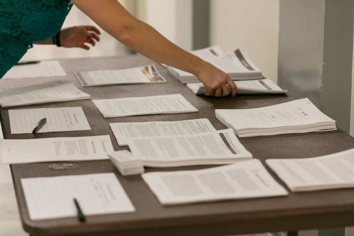 person organizing papers